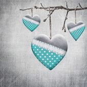 Valentine heart hanging on a tree branch — Stock Photo