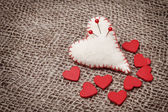 Valentine background with hand-sewn hearts — Stock Photo