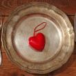 Table setting for Valentine's Day. plate, fork, knife and red hear — Stock Photo #39967739