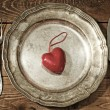 Table setting for Valentine's Day. plate, fork, knife and red hear — Stock Photo #39967747