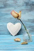Beautiful rose and apple on romantic blue background — Stockfoto