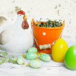 Easter table setting in green and white tones with chicken and Easter eggs. — Stock Photo #42269459
