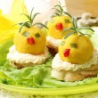 Easter breakfast. Chickens made from egg yolk with mayonnaise pu — Stock Photo #43140911