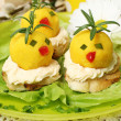 Easter breakfast. Chickens made from egg yolk with mayonnaise pu — Stock Photo #43140917