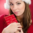 Women with red gift for christmas — Photo