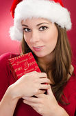 Women with red gift for christmas — Stok fotoğraf