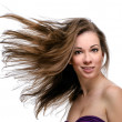 Attractive woman with flying long hair — Stock Photo