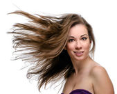 Attractive woman with flying long hair — ストック写真