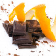 Close-up of chocolate pieces with orange — Stock Photo