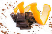 Close-up of chocolate pieces with orange — Foto Stock