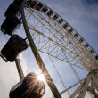 Big ferris wheel with sunbeam — Stok fotoğraf