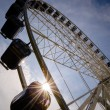 Big ferris wheel with sunbeam — Stock Photo
