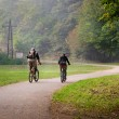 Stock Photo: Cyclists on dirt road