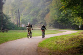 Cyclists on dirt road — Stock Photo