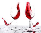 Splashing red wine — Stock Photo