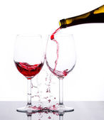 Red wine pouring — Stock Photo