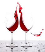Red wine splash in two glasses — Foto de Stock