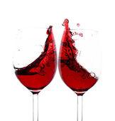 Red wine splash in two glasses — Stock Photo