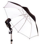 Studio strobe with umbrella isolated — Stock Photo