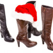 Boots and santa hat — Stock Photo