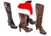 Boots and santa hat — Stock Photo