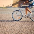 Man riding on vintage bicycle by road — Foto Stock