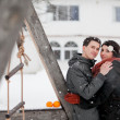Happy bride and groom in winter day - Stockfoto