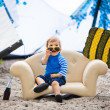 Adorable kiteboarder boy in the chair - Stockfoto