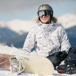 Snowboarder against sun and sky - Stockfoto