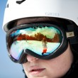 Female snowboarder against sun and sky - Stockfoto
