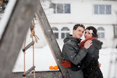 Happy bride and groom in winter day — Photo
