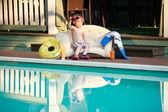 Adorable boy at the swimming pool — Stok fotoğraf