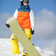 Female snowboarder against sun and sky — Stock Photo #15475797