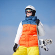 Female snowboarder against sun and sky — Stock Photo #20192809