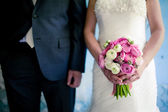 Wedding bouquet in the bride's hands — Stok fotoğraf