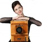 Beautiful girl posing with old camera — Stock Photo