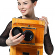 Beautiful girl posing with old camera — Stock Photo