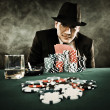 Young man playing poker — Stock Photo #40644765