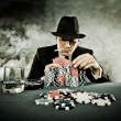 Young man playing poker — Stock Photo
