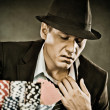 Young man playing poker — Stock Photo #40644939
