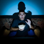 Man watching horror movie — Foto de Stock