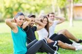 Friends exercising and stretching together — Stock Photo