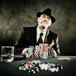 Young man playing poker — Stock Photo #43905677