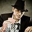 Young man playing poker — Stock Photo #43905791