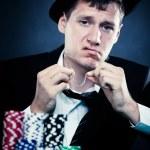 Young man gambling — Stock Photo