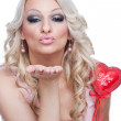 Blonde holding heart and sending kiss — Stock Photo
