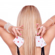 Blonde with poker — Stock Photo