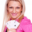 Blonde with poker of aces — Stock Photo