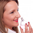 Stock Photo: Girl smelling perfume