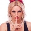 Stock Photo: Blonde with horns making hush gesture